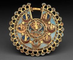 Magnificent Zoroastrian Art 2500 year old Gold Earring from the Achaemenian Empire - IRAN, Adorned with images of Achaemenian noblemen, and pieces of turquoise, onyx and lapis decorations; 5.1 cm in diameter; Circa 5th century BC, Achaemenian
