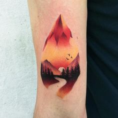 Colorful and creative mountain tattoo by Daria Stahp