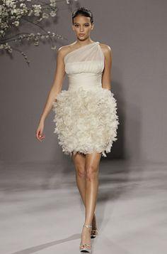 Short and sassy wedding dress by Romona keveza