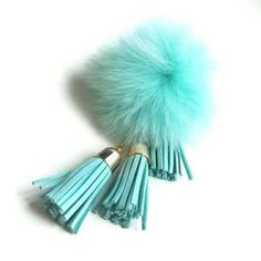 This keychain features a fur ball with 3 tassels. It's our glamorous good luck charm. • This keychain ring made with Alloy. • The fur made with rabbit fur. • Size : 8cm*15cm • Packaging : Includes a tag with packaging box