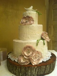 We collected vintage earrings for months for her flowers on the cake, in her bouquet and on the tables.  Labor of love :)