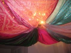 I already have saris hanging from my bedroom ceiling but they don't look as pretty as this