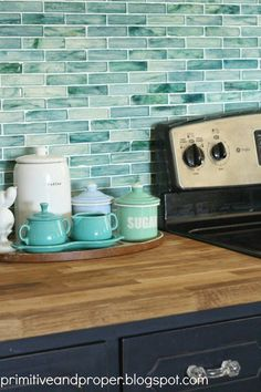 DIY aqua or turquoise recycled glass backsplash - love this pop of color in a kitchen