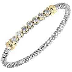 Sterling Silver & 14K Yellow Gold Cubic Zirconia Bezel Set Bar Bangle Bracelet Featuring Round Bezel Set Cubic Zirconia by Vahan available at BenGarelick.com $1475 https://www.bengarelick.com/products/vahan-sterling-silver-14k-yellow-gold-cubic-zirconia-bezel-set-bar-bangle-bracelet