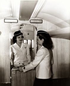Flight attendants simulate food service from the gallery of a Curtiss-Wright C-46 commercial passenger airplane. ©Missouri History Museum