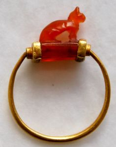 Gold finger-ring; cornelian bezel in form of cat; wedjat-eye on under-side, Third Intermediate Period (1070 BC-664 BC), Ancient Egypt & Sudan.