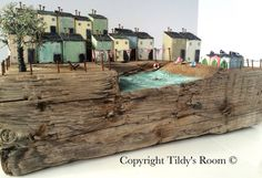A large driftwood art scene of a day out at the lido! Hand crafted statement driftwood art piece. The base is made from what I think was part of an