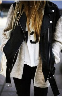 white crop top under cream cardigan under leather vest with coated black pants