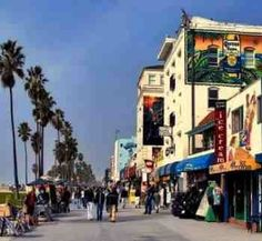 The boardwalk at Venice beach, CA. Beautiful beach, warm weather and some of the best people watching around....missing it.