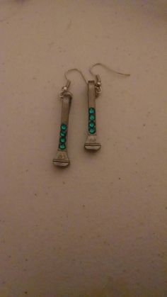 Check out this item in my Etsy shop https://www.etsy.com/listing/258292729/teal-rhinestone-horseshoe-nail-earrings