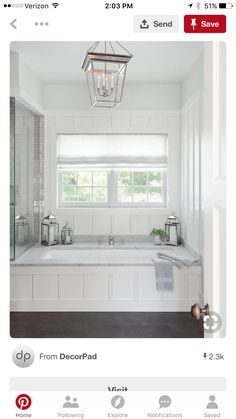 The perfect place to relax, this stunning cottage bathroom boasts a wainscoted drop in bathtub accented with a marble deck a polished nickel tub filler fixed in front of a board and batten wall framing a window dressed in a white linen shade lit by a Smal Bathtub Remodel, Master Bath Remodel, Bad Inspiration, Bathroom Inspiration, Bad Wand, Built In Bathtub, Drop In Bathtub, Bathtub Drain, Whirlpool Bathtub