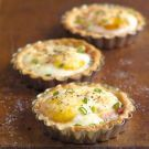 Ham and Egg Breakfast Tarts - Can substitute bacon and chives for the ham and green onions