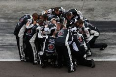 Crew members for Kevin Harvick, celebrate after winning at Phoenix