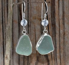 Seaglass earrings.  Unique handmade Aqua Seaglass and Sparkly CZ earrings in Sterling Silver. $44.00, via Etsy.