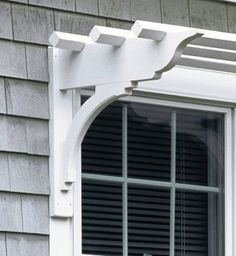 Shelf style bracket for over outdoor windows.  I could do this over the side door on the driveway.  Maybe train some plants to grow up there.