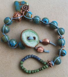 Bracelet Knotted Macrame Azure and Olive Green Ceramic Button and Beads with Antiqued Copper. $25.00, via Etsy.