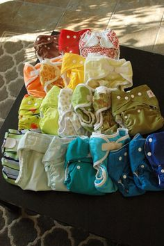 a diaper rainbow! in the ring: pockets or prefolds? pros and cons of both. #cloth #diapers. If you are considering cloth diapers, this is great info about the options out there.