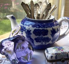 Blue and White teapot filled with vintage silver...pretty vignette