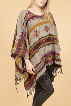 This gorgeous aztec design poncha is a perfect addition to any wardrobe. Black, red and yellow are the dominant colours on a grey background. Delicate black fringes add to its character!