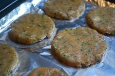 ground up chicken breasts in the food processor along with some olive oil, garlic, fresh herbs, salt, and pepper (you can also buy pre-ground chicken). I then shaped them into patties and baked them until cooked through.  I wrapped them individually in plastic wrap, and then put them all into a freezer bag