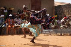 This image depicts Benin's Voodoo festival where believers come together and engage in different rituals and practices that reinforce their faith and religious identity. Emile Durkheim saw religion as functional in its ability to bring people together and establish solidarity.