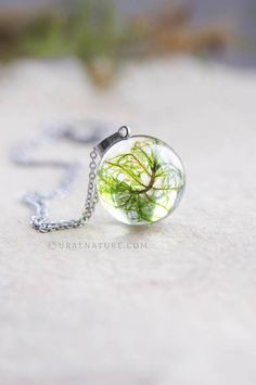 Resin casting jewelry. Necklace with real moss encased in crystal-clear  resin sphere with 05d5d39e82d