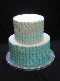 This teal ombre buttercream petal wedding cake was accompanied by 300 cupcakes. By thecakeattic.com in Salisbury, NC.