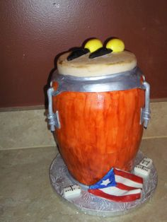 "Baker says: ""I made this conga for my brother in law's birhtday. Is a replica of his conga and maracas. He loves playing dominos and also love his island, Puerto Rico. I was only missing a bottle of coors."""