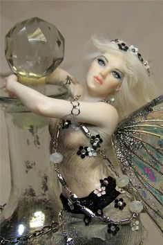 This listing is for a custom sculpted portrait, Fantasy, Fairy or Mermaid art doll made to your specifications. Each one is sculpted just for you and so they take awhile to make.