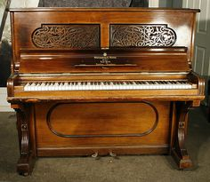 An 1886, Steinway upright piano with a rosewood case and fretwork panels at Besbrode Pianos