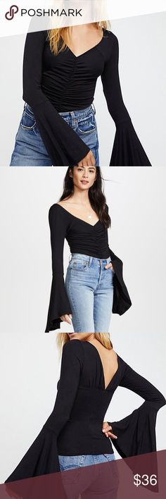 eb24805877ba2 Free People What A Babe Top Black XS NWT Trend-savvy printed blouse with  ruching detail at front Deep V-neck Long bell sleeves V-back About 23
