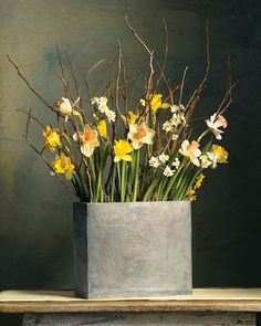 A stunning yellow arrangement with Daffodils and branches.
