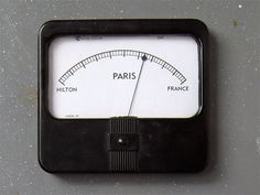 """Tim Schwartz, """"Paris - Physical,"""" a physical art piece that explores the focus of news stories about """"Paris Hilton"""" versus """"Paris, France"""" in a single needle gauge.  Caption paraphrased from Information Aesthetics at http://infosthetics.com/archives/2009/03/news_as_physical_data_art.html"""