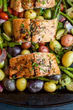 Sheet Pan Balsamic Salmon on a bed of potatoes, asparagus, and brussels sprouts! An easy healthy meal done in 30 minutes and full of bold flavors you'll love! | #paleo #glutenfree: