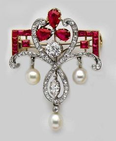 Edwardian Calibré Burma ruby, pear-shaped Burma ruby, natural pearl, diamond gold and platinum brooch. the-rouge-rose2u.tumblr.com