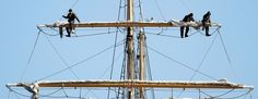 Crew members aboard the U.S. Coast Guard training barque Eagle, from left, Seaman Garrett Henderson, Seaman Toler Alexander and Boatswain's Mate Third Class Frona Walls Parrish, rig the foresail while docked Monday at Fort Trumbull State Park in New London.