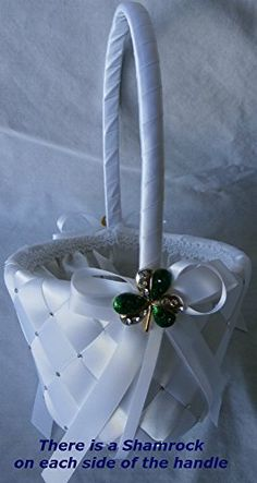 White Wedding Flower Girl Basket for Irish, St. Patrick and Shamrock Wedding Themes. It Is Hand Woven and Embellished with Swarovski Crystals and a Silver and Green Crystal Studded Shamrock. There are also matching: guest books, pen sets, ring pillows, bridal purses and garters. Everything Wedding and Beyond http://www.amazon.com/dp/B00N8EPCJE/ref=cm_sw_r_pi_dp_5Y.2ub0PTB87S
