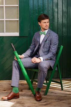 A sharp blue suit with a fresh grass green check - accessorize with a green bow tie and green socks!