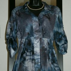 So classy! Pretty draped tunic-length top in shades of blue and grey. Tops