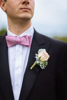 Pink Rose Boutonniere with Dusty Miller. The groom's boutonniere: It's an essential wedding detail, but one most brides will admit they don't give too much thought to. Sure, it's easy enough to select one bloom from your bouquet and have your florist create something to pin to your guy's lapel, but as much as you love that bright pink peony bouquet, we have a feeling he'd prefer a bit more masculine on his suit jacket.