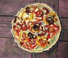 Spinach and goat cheese tart with roasted peppers and tomatoes