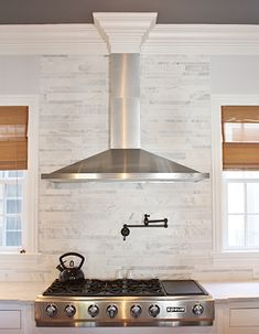 Kitchen range hood. I like the crown molding, but the seam in the duct cover would make me insane.