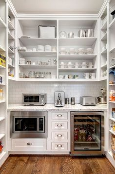 Wow. What a walk-in pantry. I like the notion of putting a drink fridge in the pantry, and the counter-top toaster to keep it out of the main kitchen area, but this seems to take mucho square footage. by malinda