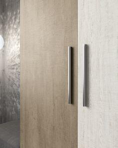Detalle del tirador modelo Asia en armario puertas batientes