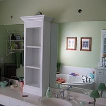 I added shelves and some trim to dress up the large bathroom mirror.… :: Hometalk