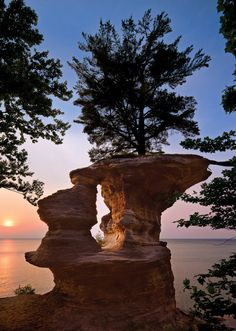 "Chapel Rock, Chapel Beach area, Pictured Rocks National Lakeshore, Michigan  ""The rock is famous for its interesting structure and the white pine growing on top. The tree is connected by a thick root on the right that crosses open space to get nourishment from the hillside just out of the frame. There used to be a land bridge across this void."
