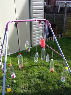 Lots of plastic bottles filled with different things then hung on an old swing via Sarah Blaylock ≈≈ Has got me thinking of all sorts of ways to use old swing surrounds!