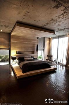 Wooden headboard extending to ceiling, with platform bed