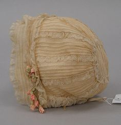 Early 20th c cotton & silk cap. (Acknowledgments to http://www.metmuseum.org/)