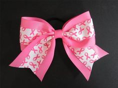 BREAST CANCER AWARENESS CHEERLEADING BOW!! HOT PINK WITH BREAST CANCER RIBBON!! SOME PROCEEDS FROM EACH BOW GO TO SUSAN G. KOMEN!!  $6